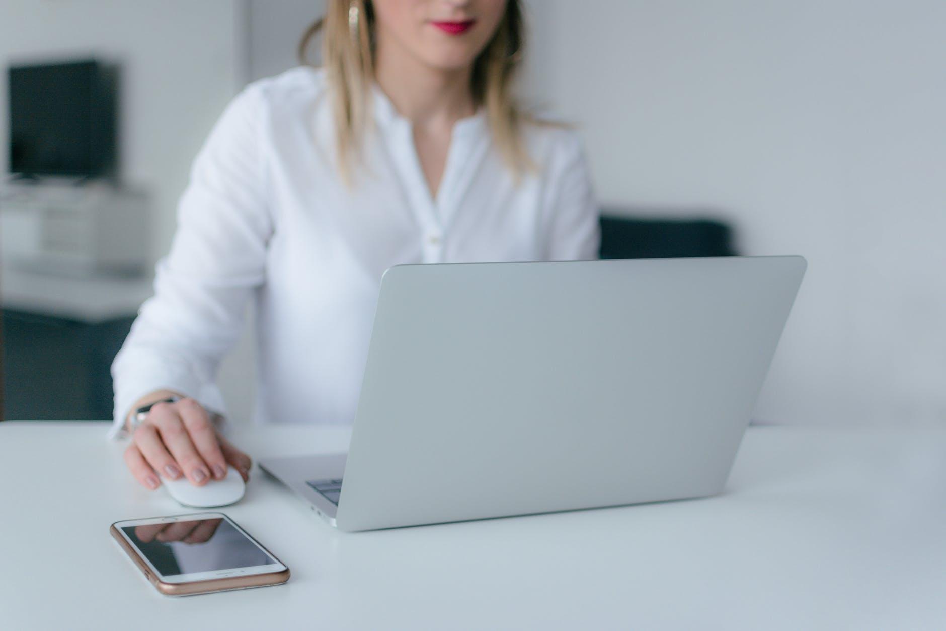woman using silver laptop